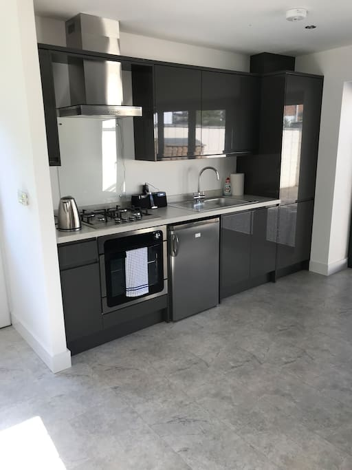 Kitchen in the open plan living area. Hob, oven, microwave and fridge all new.