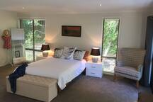 Master bedroom with wall mounted TV and air con.