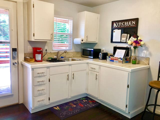 Fully equipped Kitchen with Coffee Maker, Microwave, Toaster, Refrigerator, Stove/Oven, & Kitchenware.