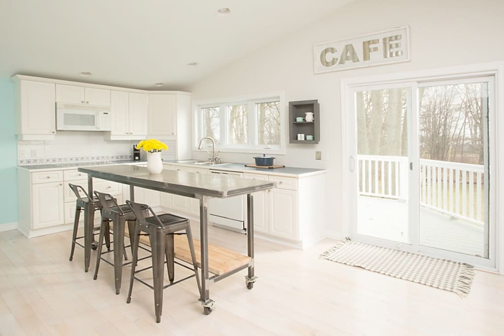 Main House: Large, fully stocked kitchen with walkout to Upper Deck