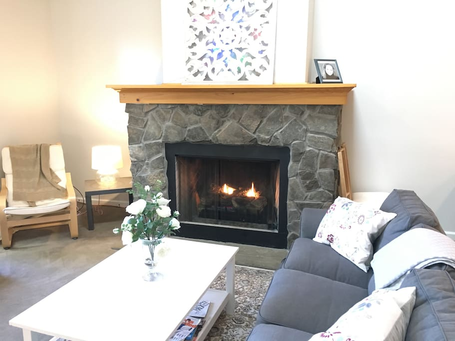 """Great room with gas fireplace, skylight and 55"""" TV."""