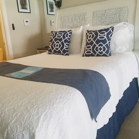 Second floor bedroom, with view of the Gulf of Mexico and private half bath. Access to second floor balcony and views of the Choctawhatchee Bay and Seacape Golf Course. (Queen bed)