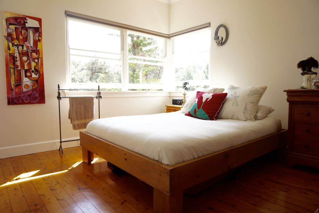 Main: Bright and beautiful mornings. Super comfortable queen size bed and latex mattress. Nights are quiet and dark with parkland backdrop and blackout blinds.