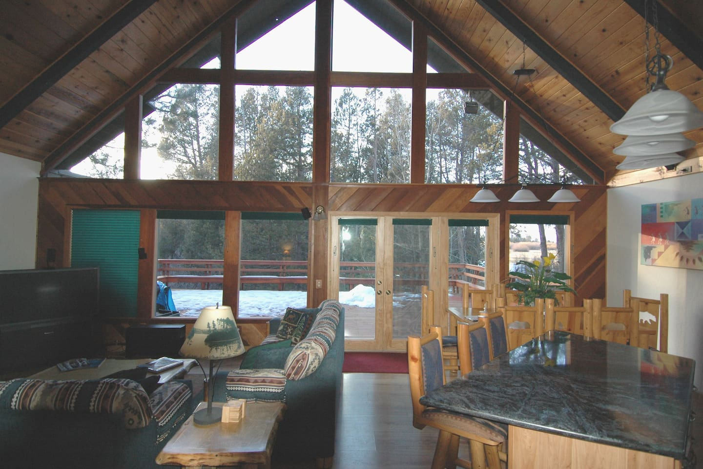 Family room with 20' ceiling, fan. Large deck with views of mountains and meadow, slight lake view