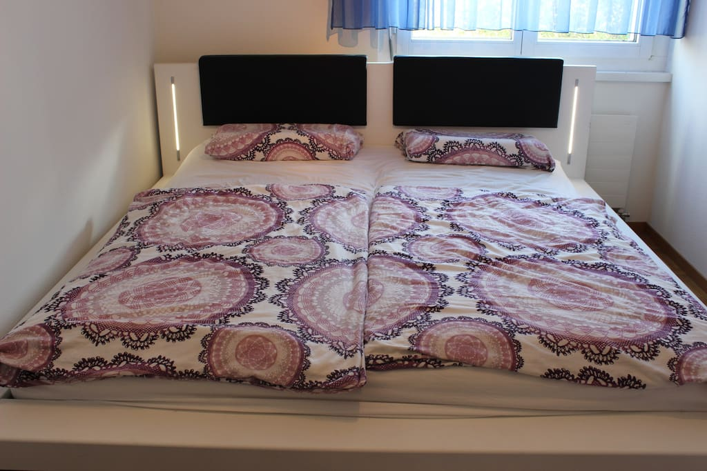 Your double bed (1.8m wide) with lights on the side