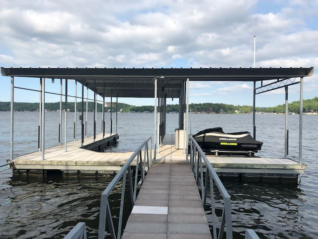 Your own private dock with boat slip and PWC lift (bring/rent your own boat or jet ski) [Seadoo pictured not included]