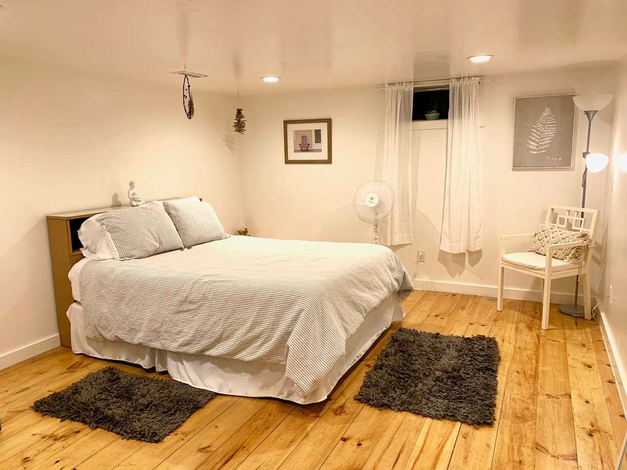 "Lovingly called the ""Earth Room,"" one of these two rooms includes a dreamcatcher and driftwood mobile made by a local artisan here on Martha's Vineyard!"
