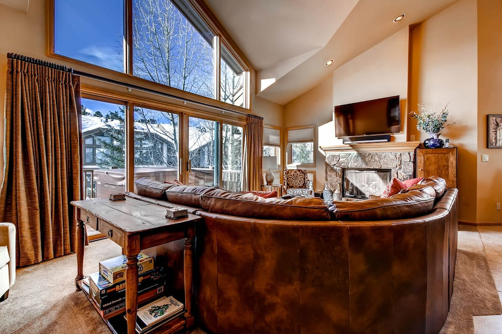 Living Area with Flat Screen TV, Gas Fireplace and Floor to Ceiling Windows