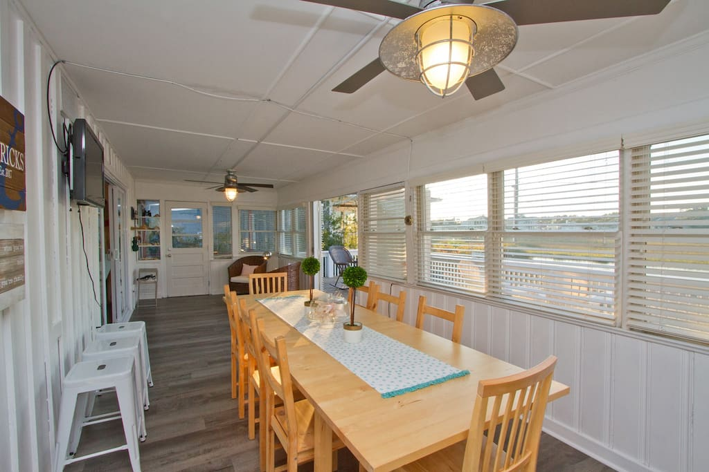 Large family-friendly eating area on the front porch.