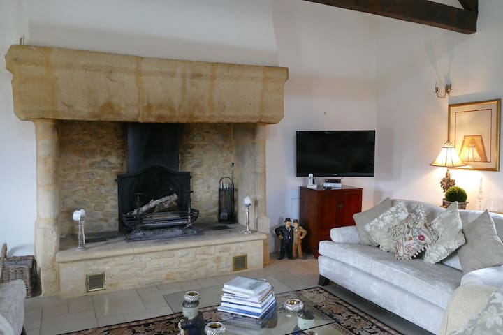 Lounge has a traditional stone fireplace or 'cantou'