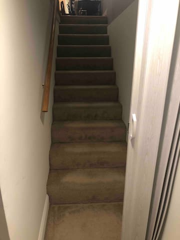 Stairs leading to the basement room.