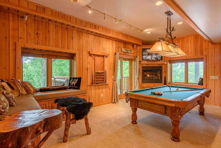 Downstairs game room with pool table, gas log fireplace,comfortable seating