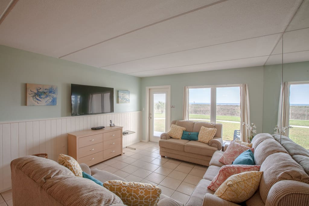 Living room with ocean view. Walk out to the beach and pool from the living room patio