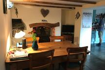 Dining area with woodburner and slate floors