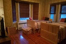 2 Beds in Main Room. Can be put together perfectly to make one bed for a couple.