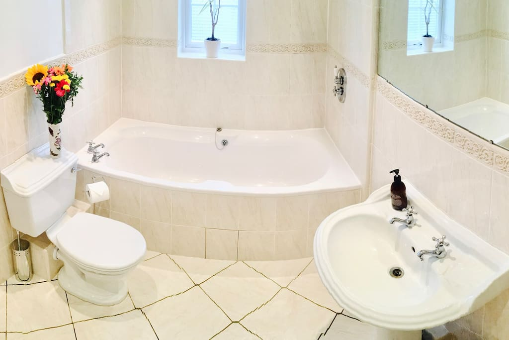 Victorian Style Bathroom with a relaxing beautiful Villeroy & Boch Bathtub. This Bathroom also has a Rain Shower.