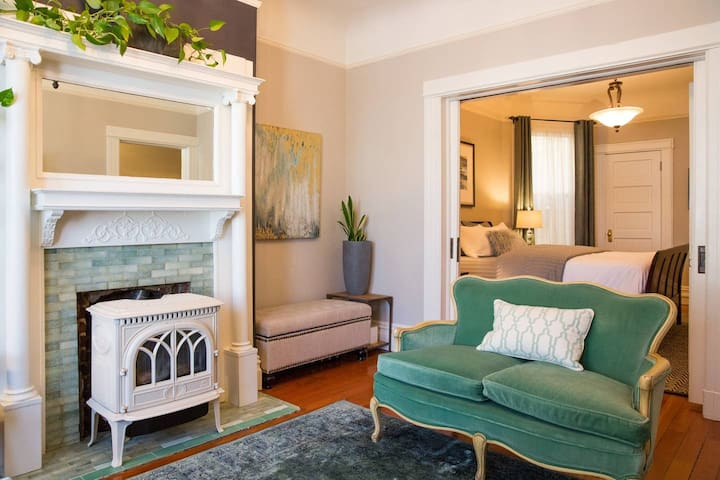 Gas fireplace and pocket doors to bedroom