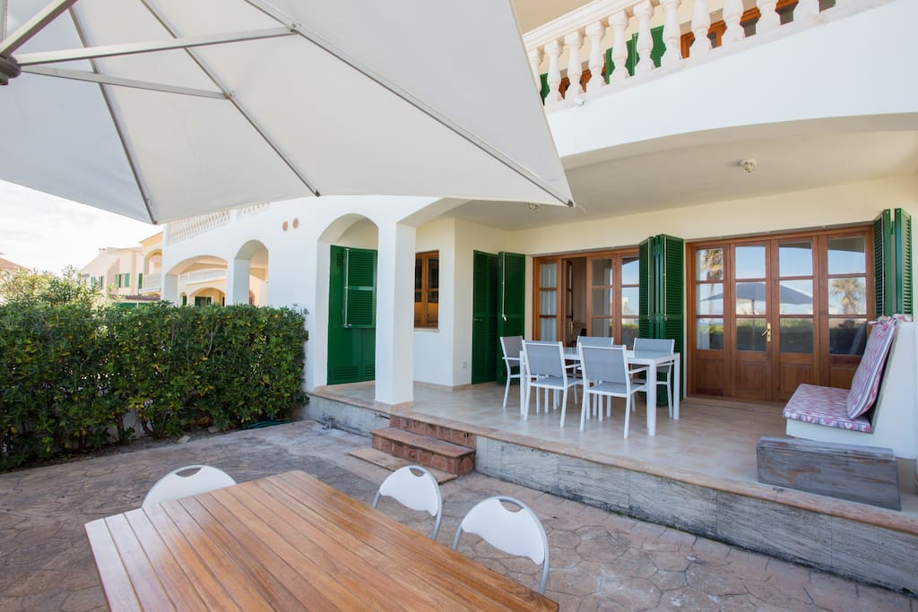 Spacious private terrace space with 2 dining tables under shade and sun.