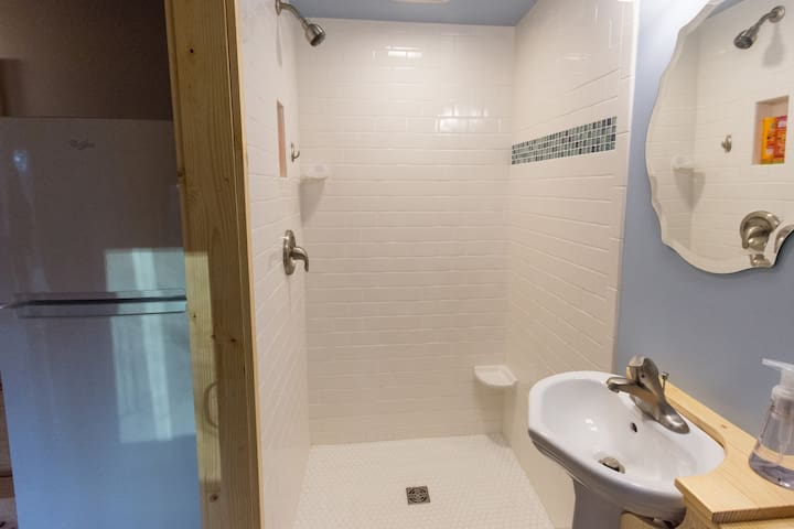 Full size subway tiled shower...endless hot water and great pressure!