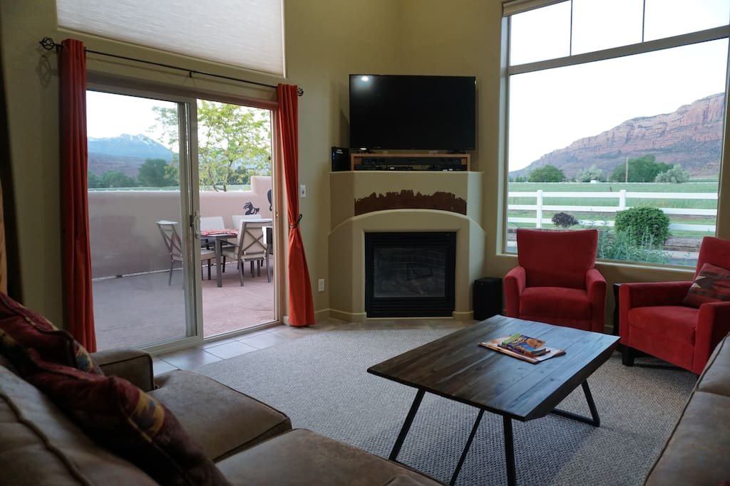 Living room includes gas fireplace and spectacular views of the La Sal Mountains and the Moab Rim
