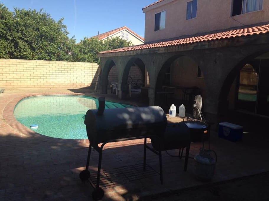 Backyard with pool and grill. Plenty shade for gatherings unde shady porch.