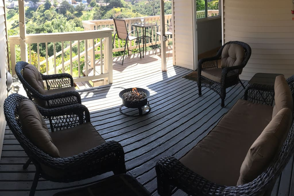 Cozy covered deck area with a gas fire pit and view of the canyon.