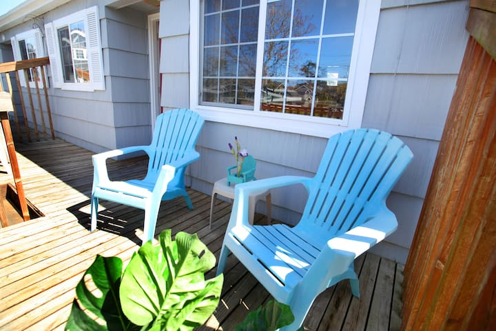Private entry patio with chairs