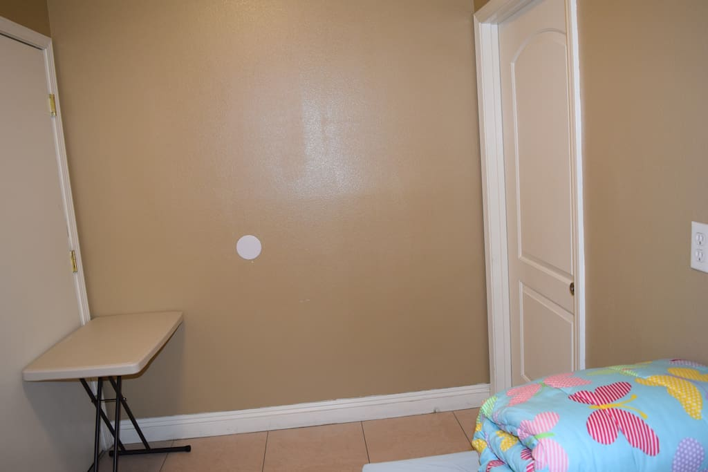 small room with door and lock