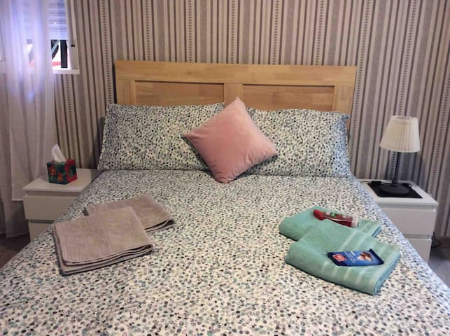 Master bedroom . A good sized double bed , perfect for a good nights sleep . This room has an ensuite shower and wash basin , but please note this little wash room does not have a toilet .
