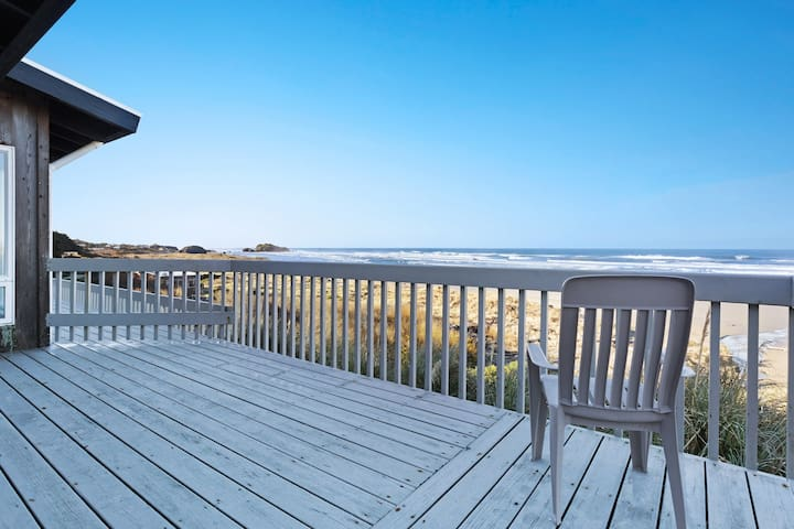 Dog-friendly, oceanfront condo w/ beach access, cozy fireplace, and large deck