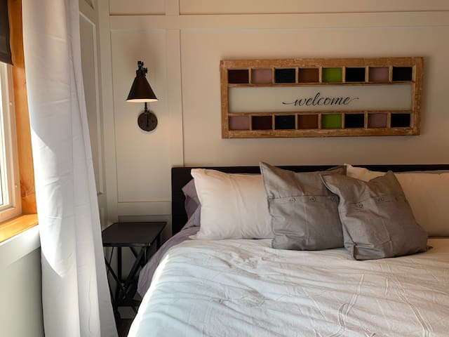 Natural light with side table at king bed