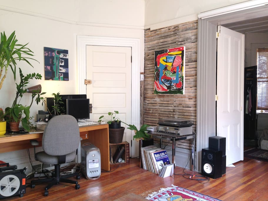 This is our rustic wall and desk zone. The rustic wall features a painting by a local artist, if you can believe that.