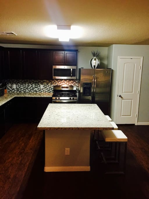 Kitchen is large and has lots of storage space