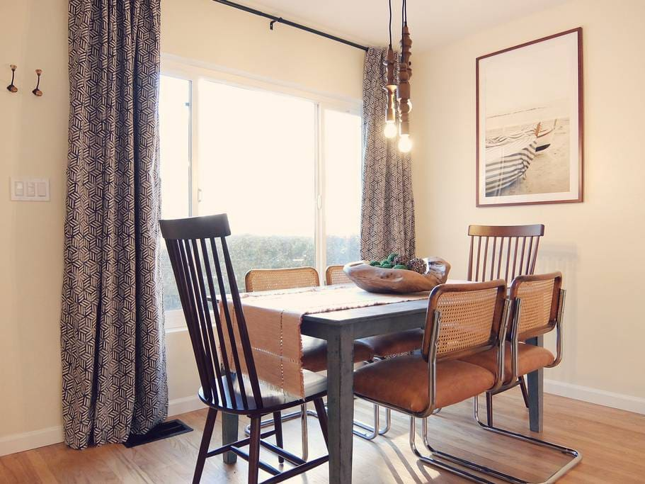 Stylish dining room 1 of 2 with seating for up to 6