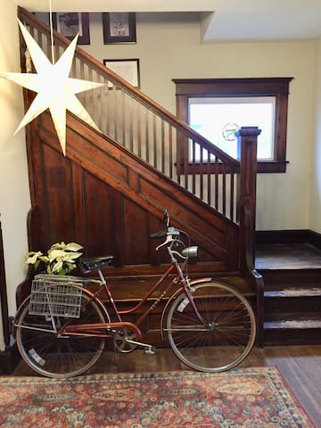 This is the entry to Hamilton House. And that's one of two vintage bicycles I make available to guests. Cycling into downtown Indy is quick and easy. I provide locks, helmets, and maps. Just ask.