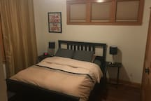 Private guest room with queen bed, large closet, luggage rack, charging outlets on each night stand and more!