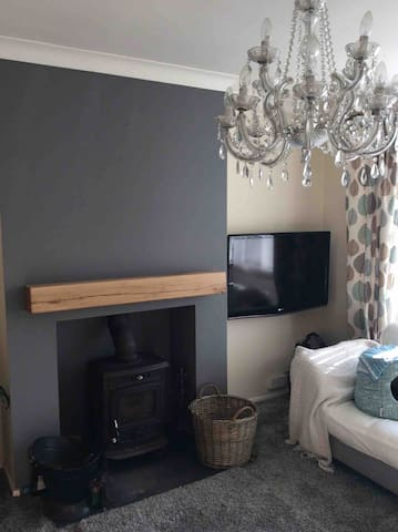 Smart TV, including chrome cast facility from phone or tablet. Multi fuel burner for that touch of cosy relaxation.