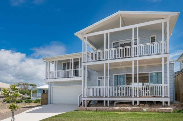 THE CHALET, designer beach home with heated pool!