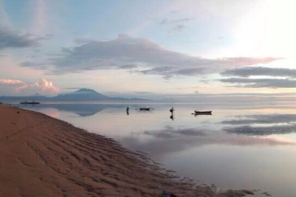 Sanur sunrise with low tide with view of the biggest Bali volcano mount Agung