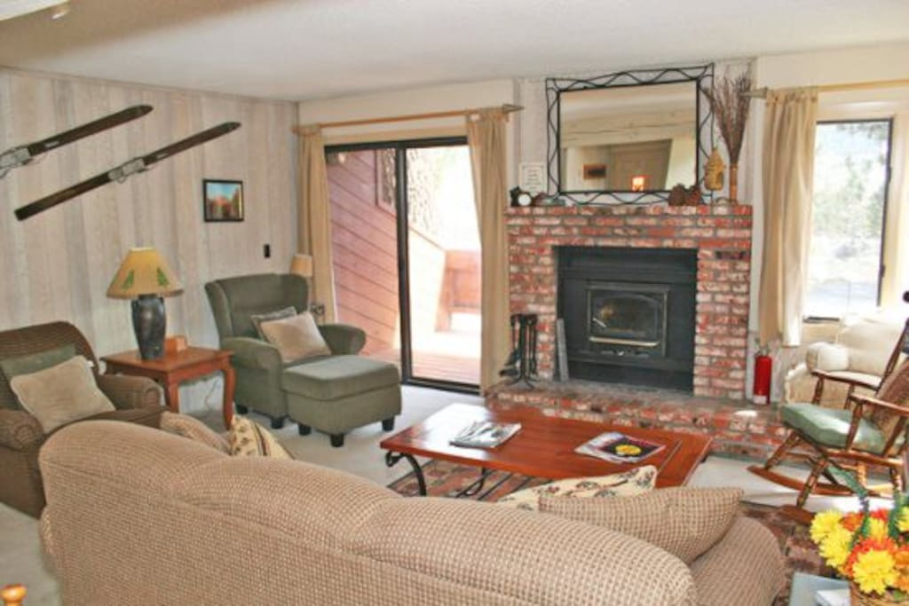 Mammoth Lakes Condo Rental Sunrise 12 - Living Room has a Woodstove and Comfortable Seating