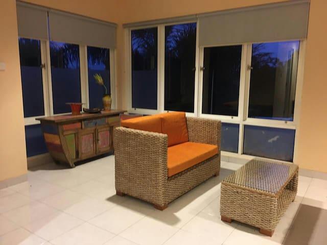 Puri 12-1BR Orange room-pool rice field view