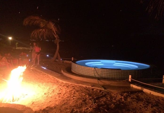 Enjoy an exciting bonfire by the pool side as you watch the pool change up to 6  exotic colors.