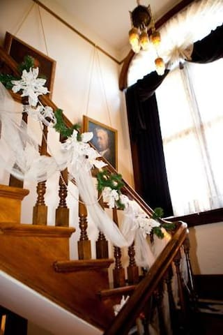 Beautifully decorated front stair case.