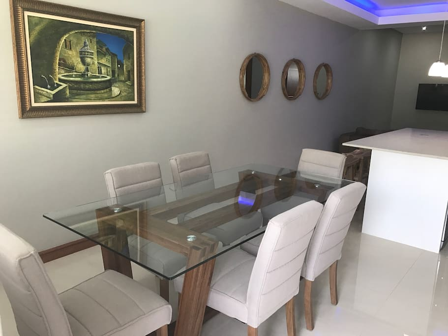 Dining room with six seater table and chairs.
