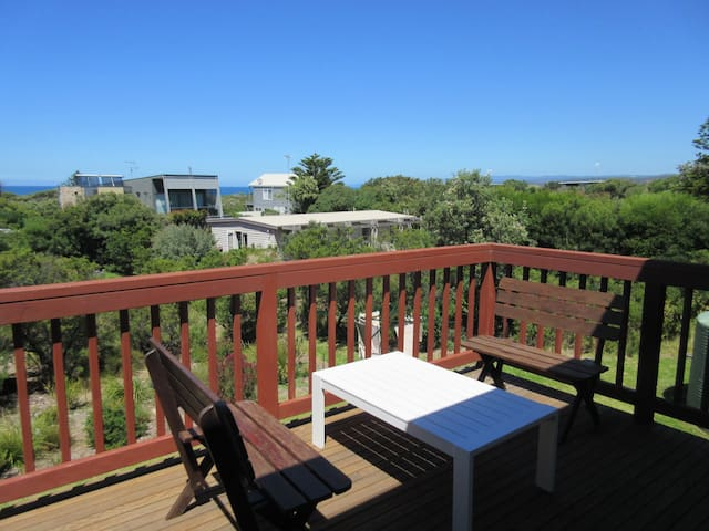 Large sunny deck, perfect for outdoor drinks, meals, or simply lounging.