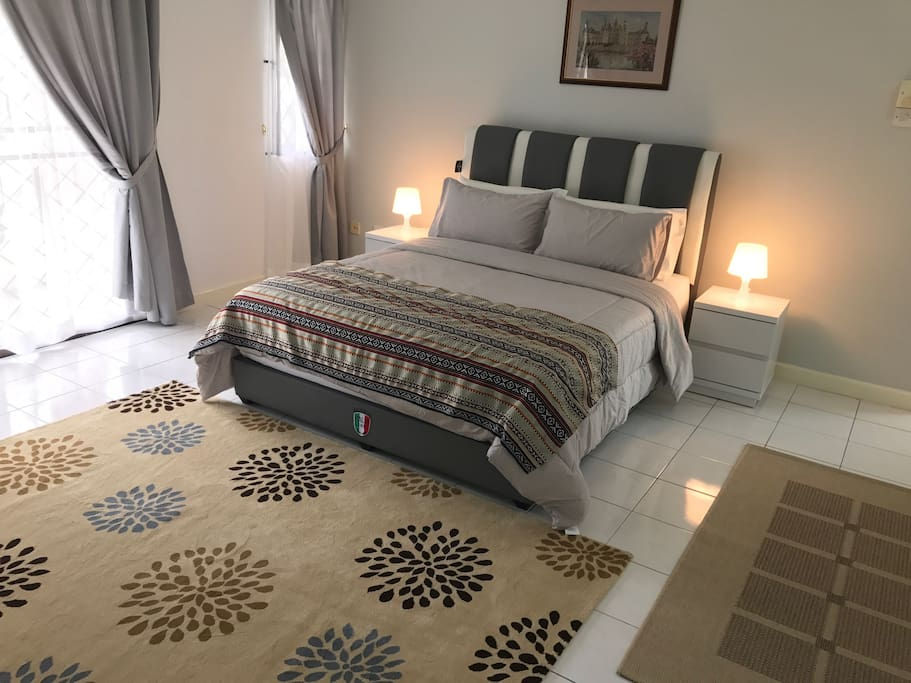 Bedroom A sleeps 2 guests, has private bathroom & shared balcony