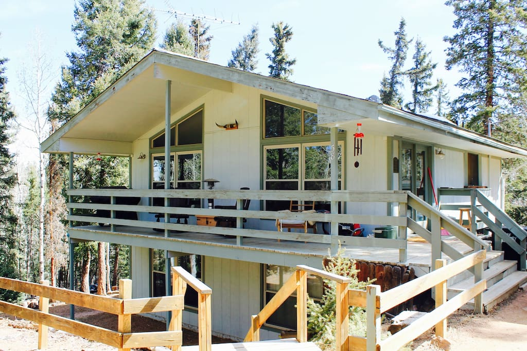 This is the front of our home. It is two levels, and wooden stairs take you to the back woods area that you see in the cover photo. Our home was built in 1976, and it is in need of a paint job. We hope to accomplish that this summer! But for now, we have been working on painting and freshening up the inside with our personal touches. The front door is on the right side there. You can park right by the front steps and walk right in.