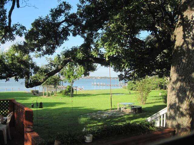 Expansive view of Clear Lake over the manicured rolling lawn to the waters of Clear Lake.  Majestic oaks pines and magnolia trees provide ample shade to enjoy the prevailing breeze off the lake.