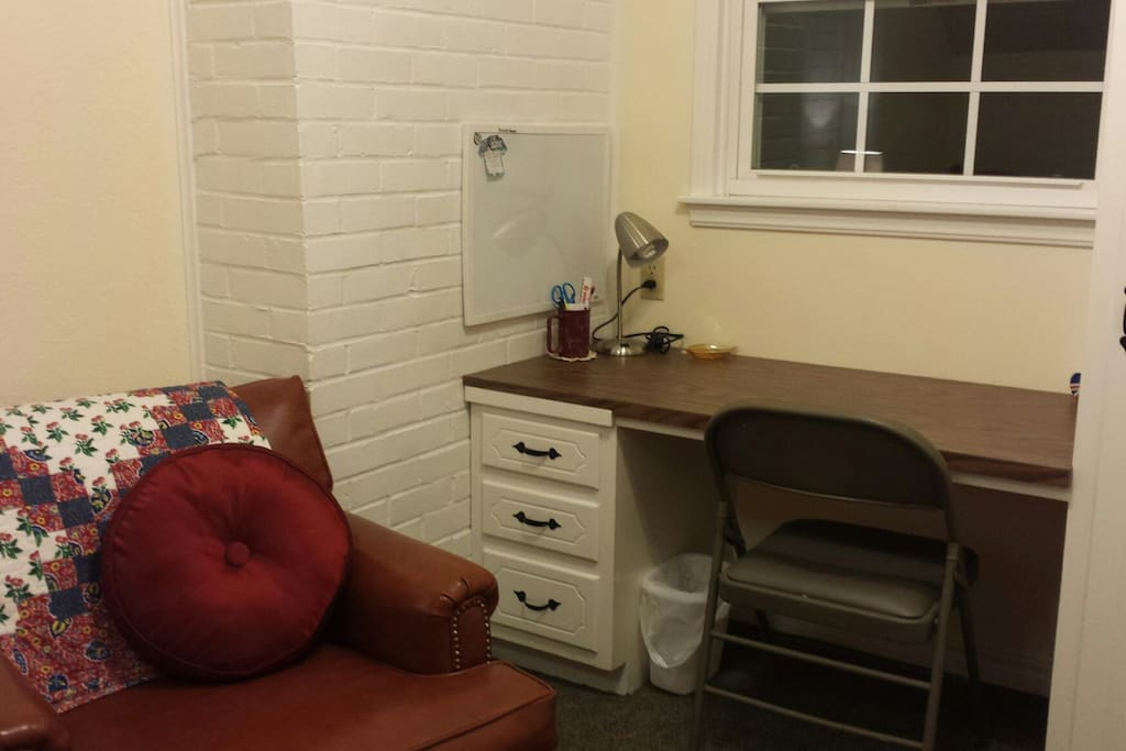 Desk, wifi, & chair. Window with light blocking shade. Window  has a/c unit for individual comfort in summer.