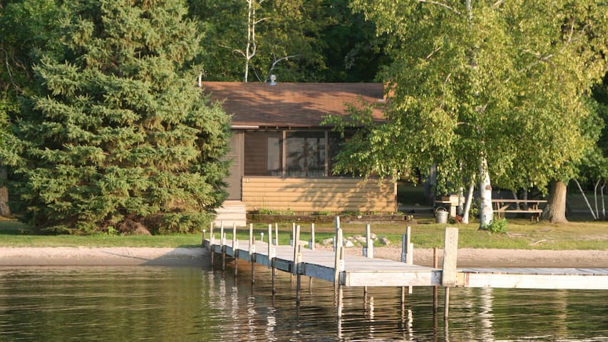 Lakeside cabin just steps away from the water and dock.